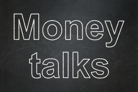 Business concept: text Money Talks on Black chalkboard background