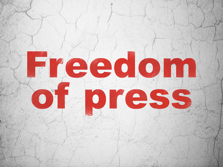 Political concept: Red Freedom Of Press on textured concrete wall background