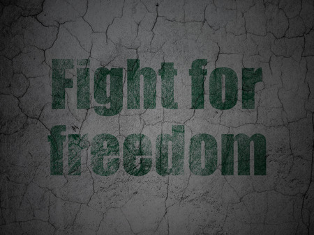 Political concept: Green Fight For Freedom on grunge textured concrete wall background Stock Photo