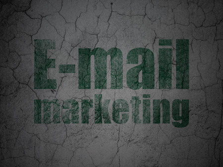 Marketing concept: Green E-mail Marketing on grunge textured concrete wall background Banco de Imagens