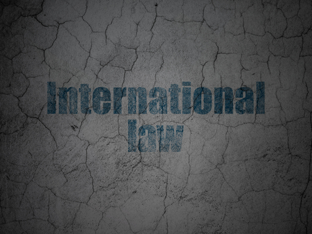 Political concept: Blue International Law on grunge textured concrete wall background