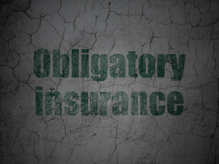 Insurance concept: Green Obligatory Insurance on grunge textured concrete wall background Stock fotó