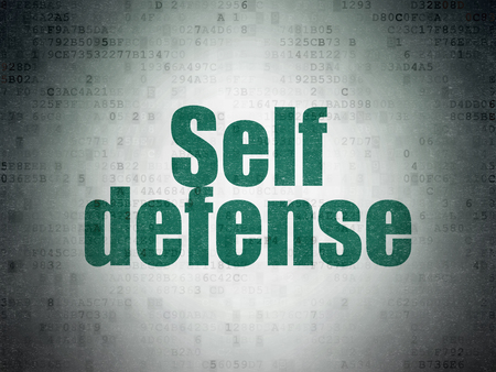 Security concept: Painted green word Self Defense on Digital Data Paper background Archivio Fotografico