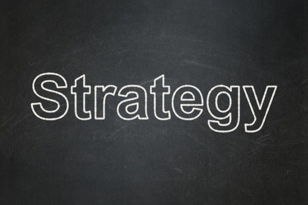 Business concept: text Strategy on Black chalkboard background