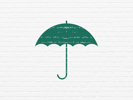 Protection concept: Painted green Umbrella icon on White Brick wall background