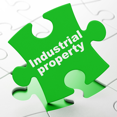 Law concept: Industrial Property on Green puzzle pieces background, 3D rendering