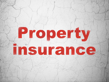 Insurance concept: Red Property Insurance on textured concrete wall background