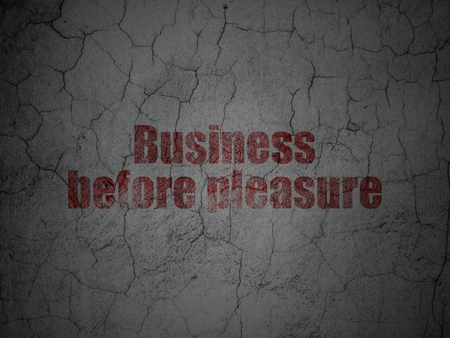 Business concept: Red Business Before pleasure on grunge textured concrete wall background Stock Photo