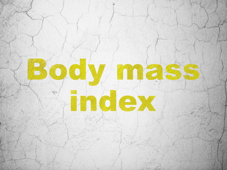 Medicine concept: Yellow Body Mass Index on textured concrete wall background