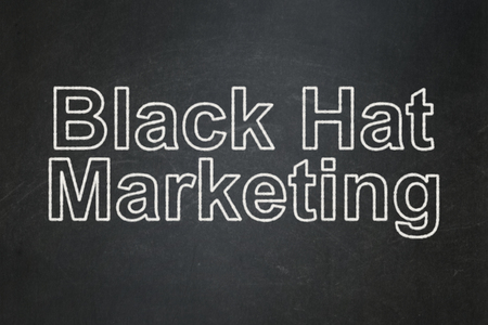 Business concept: text Black Hat Marketing on Black chalkboard background