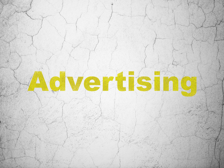 Marketing concept: Yellow Advertising on textured concrete wall background