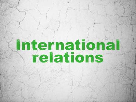 Political concept: Green International Relations on textured concrete wall background Stock Photo
