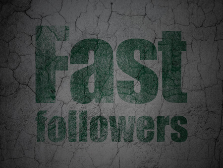 Finance concept: Green Fast Followers on grunge textured concrete wall background
