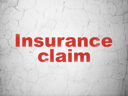 Insurance concept: Red Insurance Claim on textured concrete wall background Stock Photo