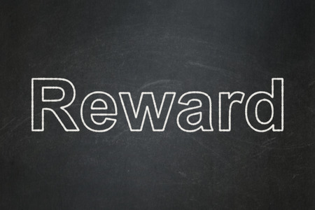 Business concept: text Reward on Black chalkboard background