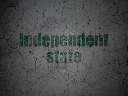 Politics concept: Green Independent State on grunge textured concrete wall background
