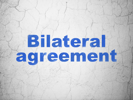 Insurance concept: Blue Bilateral Agreement on textured concrete wall background Stock Photo - 91386144