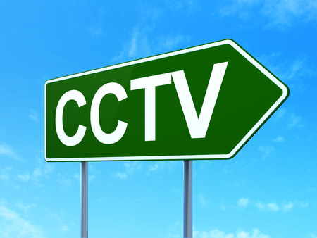 Security concept: CCTV on green road highway sign, clear blue sky background, 3D rendering Imagens