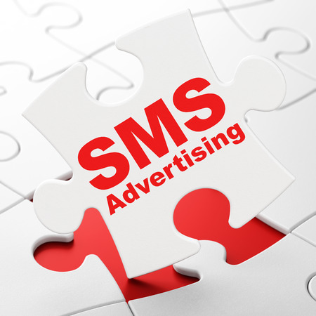 Marketing concept: SMS Advertising on White puzzle pieces background, 3D rendering Stock Photo