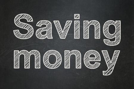 Business concept: text Saving Money on Black chalkboard background