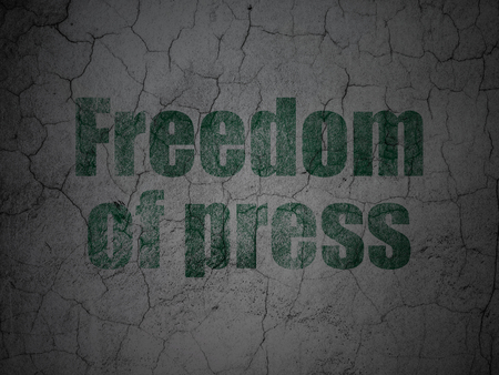 Political concept: Green Freedom Of Press on grunge textured concrete wall background