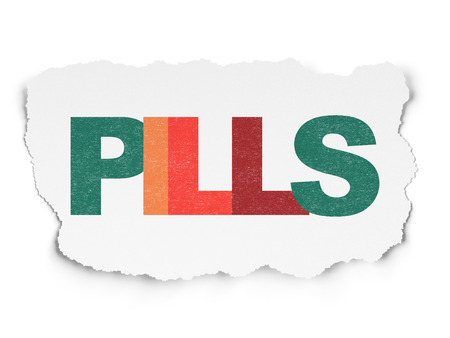 Health concept: Painted multicolor text Pills on Torn Paper background