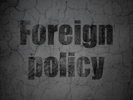 Politics concept: Black Foreign Policy on grunge textured concrete wall background