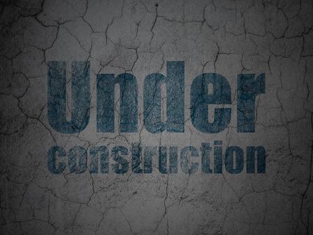 Web development concept: Blue Under Construction on grunge textured concrete wall background