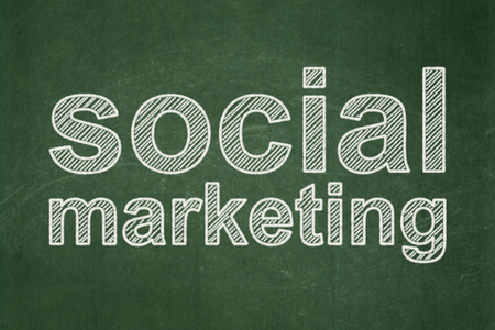 Advertising concept: text Social Marketing on Green chalkboard background