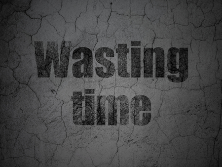 Timeline concept: Black Wasting Time on grunge textured concrete wall background Stock Photo