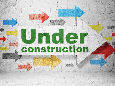 Web design concept:  arrow with Under Construction on grunge textured concrete wall background, 3D rendering Standard-Bild