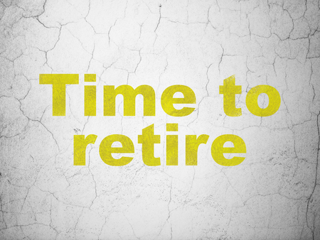 Time concept: Yellow Time To Retire on textured concrete wall background