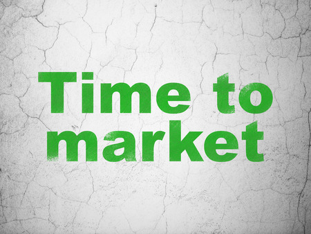 Time concept: Green Time to Market on textured concrete wall background Stock Photo