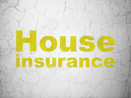 Insurance concept: Yellow House Insurance on textured concrete wall background Stock Photo