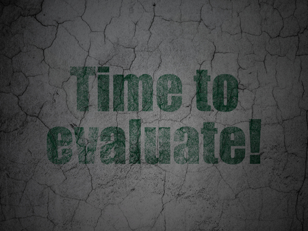 Timeline concept: Green Time to Evaluate! on grunge textured concrete wall background