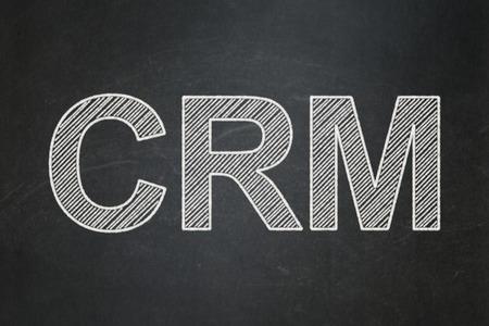 Finance concept: text CRM on Black chalkboard background Banco de Imagens