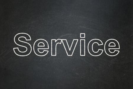 Business concept: text Service on Black chalkboard background Banco de Imagens