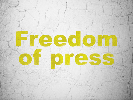 Politics concept: Yellow Freedom Of Press on textured concrete wall background