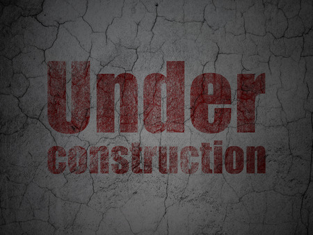Web design concept: Red Under Construction on grunge textured concrete wall background Stock Photo