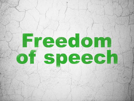 Politics concept: Green Freedom Of Speech on textured concrete wall background Stock Photo
