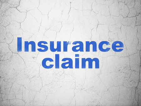 Insurance concept: Blue Insurance Claim on textured concrete wall background