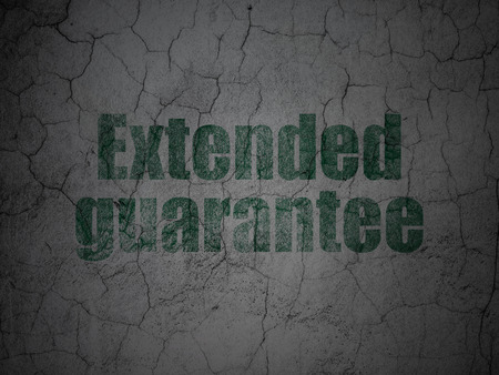 Insurance concept: Green Extended Guarantee on grunge textured concrete wall background