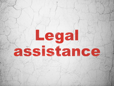 Law concept: Red Legal Assistance on textured concrete wall background Reklamní fotografie