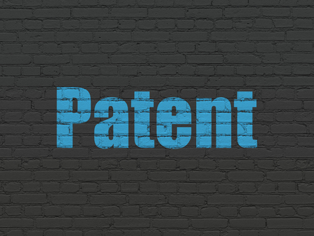 Law concept: Painted blue text Patent on Black Brick wall background