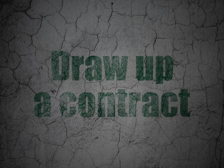 Law concept: Green Draw up A contract on grunge textured concrete wall background