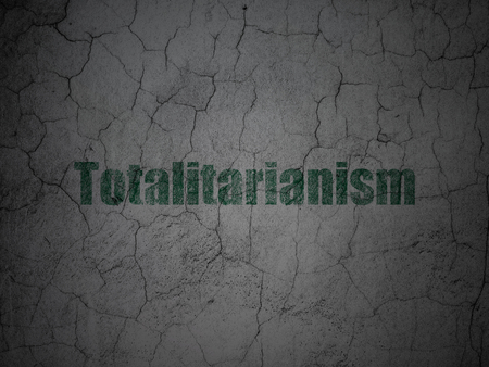 Political concept: Green Totalitarianism on grunge textured concrete wall background