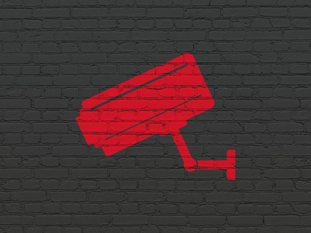 Privacy concept: Painted red Cctv Camera icon on Black Brick wall background