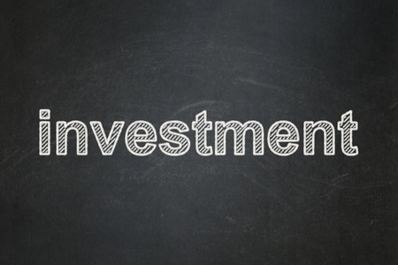 Business concept: text Investment on Black chalkboard background