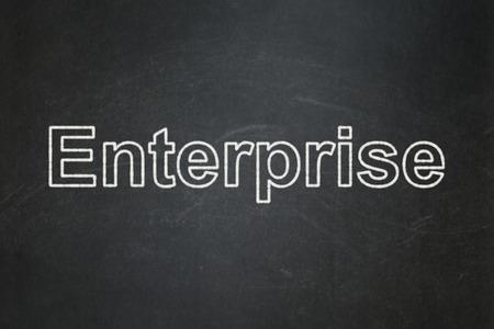 Finance concept: text Enterprise on Black chalkboard background
