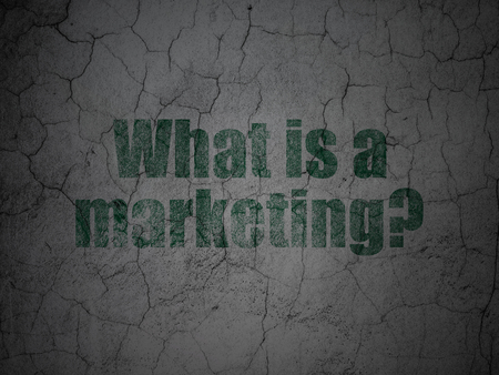 Marketing concept: Green What is a Marketing? on grunge textured concrete wall background